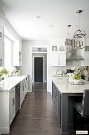 white kitchen cabinets grey wood floor white and grey kitchen a hardware update citrineliving