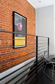 photos hgtv modern black hallway and staircase with brick accent