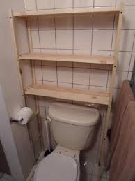 diy over the toilet shelving unit one house one couple diy