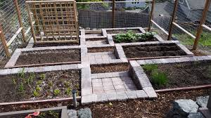 paver patio tiered vegetable garden basalt walls concrete lawn