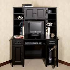 high black wooden desk with shelves and storage also space for