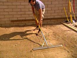 Covering Old Concrete Patio by Laying Pavers For A Backyard Patio Hgtv