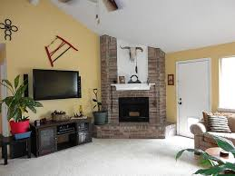 corner fireplace vaulted ceiling living rooms with brown leather