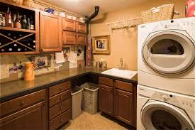 Storage Cabinets For Laundry Room Craftsman Laundry Room With Built In Bookshelf U0026 Simple Granite
