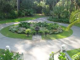 circular driveway on a hillside this plan is a xeriscape front