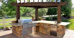 exterior backyard with an outdoor kitchen design natural wooden