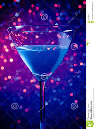 one glass blue cocktail on blue and violet tint light background