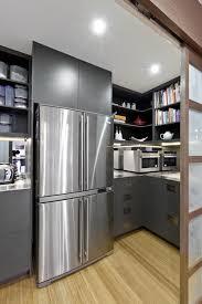 above cabinet storage over the fridge storage corner linen closet in an upstairs hall