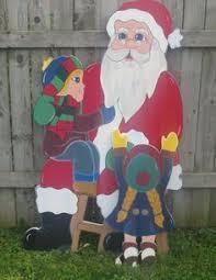 mickey mouse dressed as santa yard by playfulyardart