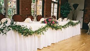 wedding reception bridal table flowers top table hanging pink