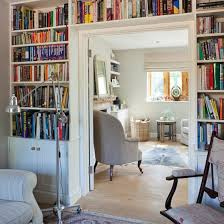 built in bookcases around double doorway in study country house