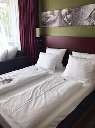 big bed pillows bed and extra big pillows picture of leonardo hotel residence