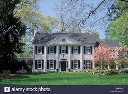 colonial house white colonial house pink dogwood trees columns lawn buckhead