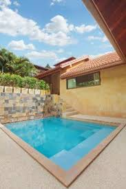 Backyard Pool Designs by Two Square Cantilever Umbrellas Providing Great Shade Coverage