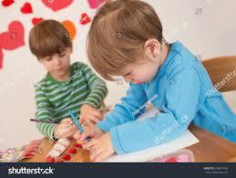 kids children doing valentines day arts stock photo 249674155