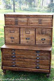 beautiful black filing drawers with brass handles that look like