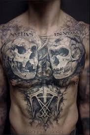 gray washed style black ink chest tattoo of monkey skulls with