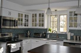 interior gray glass subway tile backsplash with white floating