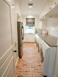 laundry room floor cabinets laundry room with white cabinets and brick flooring house interior