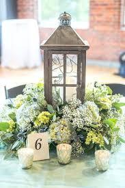 lanterns for wedding centerpieces a white lantern with fresh