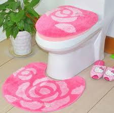 Decorative Toilet Seat Covers With Pink Rugs And Wooden Flooring