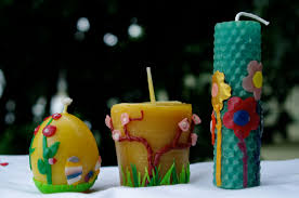 Easter Egg Decorating Beeswax passengers on a little spaceship decorating spring candles