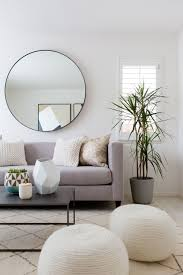 Grey Linen Sofa by Round Mirror Grey Linen Sofa Coil Ottomans Plant Etc Are