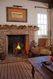 Country Living Room by Photos Hgtv Country Living Room With Brick Fireplace And Plaid