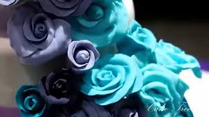 blue and purple wedding wedding cake cascading roses in shades of purple and aqua blue
