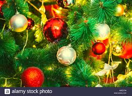 beautiful decorated christmas tree with red and goldish baubles