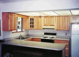 small u shaped kitchen with island black white tile backsplash