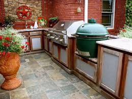 outdoor kitchen l shaped island with stainless grill and big