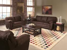 back of couch table decorate living room brick wall black upholstery leatherette couch