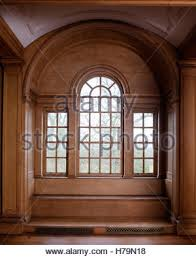 Window With Seat - detail of arched window in building stock photo royalty free