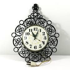black wrought iron table clock vintage wall clock 70s electric timex black wrought iron look