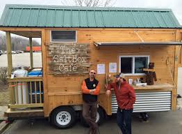 tiny house food truck makes portland debut urban eye owner matthew glatz far right and builder nick rofe outside their tiny house with big taste