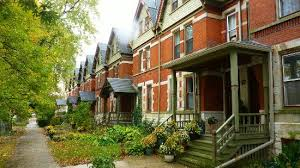 the middle class housing on 112th st in the dutch colonial style