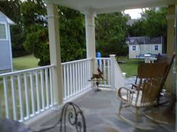 Front Porch Column Covers by Marvelous Decorating Ideas Using Rectangular Brown Wooden Rocking