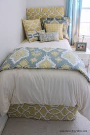 snug dorm room decor with soft yellow accent on white single bed