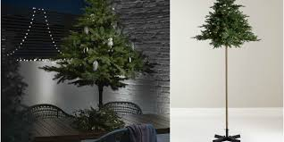 john lewis is selling a pre lit outdoor parasol christmas tree