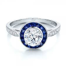 art deco style blue sapphire halo and diamond engagement ring blue