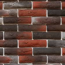 red and black brick wall wall made up of red black and ash grey