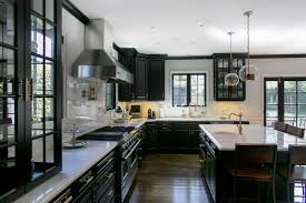 black cabinets white countertops hudson house transitional kitchen los angeles by jessica