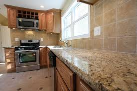 what color granite goes with honey oak cabinets granite countertops with honey oak cabinets trekkerboy