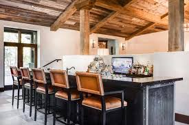 black metal wet bar with orange leather barstools country