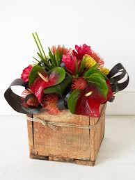 Small Wooden Boxes For Centerpieces by Escape To The Tropics With An Exotic Floral Centerpiece Hgtv