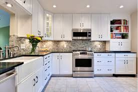 backsplash ideas for black granite countertops and white cabinets