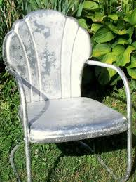 How To Redo Metal Patio Furniture - painting metal chairs