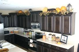 whats on top of your kitchen cabinets home decorating what to put on top of kitchen cabinets for decoration holiday decor