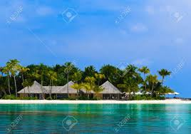 water bungalows on a tropical island travel background stock